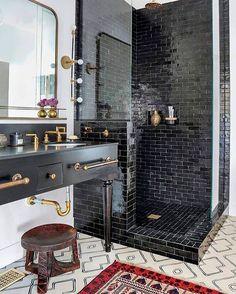 Bathroom goals: black tile shower and vanity with gold fixtures