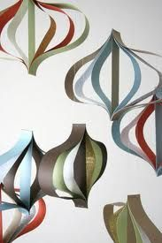 Modern paper ornaments ~ Design Sponge (maybe to hang from Eden's bedroom ceiling? Paper Ornaments, Christmas Ornament Crafts, Ornaments Design, Noel Christmas, Holiday Ornaments, Handmade Christmas, Holiday Crafts, Christmas Decorations, Paper Decorations