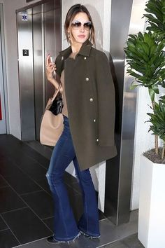 This Is How Alessandra Ambrosio Does Airport Style #refinery29  http://www.refinery29.com/2015/03/84470/alessandra-ambrosio-flared-jeans-outfit