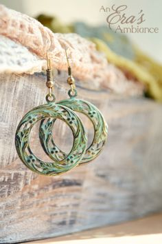 """The """"Patina Portal"""" Earrings are a floral design with patina hue"""
