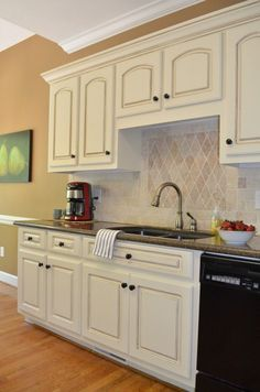 Like how athomewiththebarkers.com did her kitchen cabinets. The off white and then the glaze...gorgeous. Cabinets are Sherwin Williams Cashmere paint in Antique White and put on with a foam roller and the glaze is Valspar paint in Raw Umber