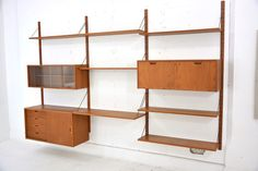 Teak shelving system Model EXCELLENT Sv. Ellekær design  £2450  304cm Wide