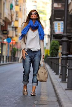 A beige coat and navy boyfriend jeans feel perfectly suited for weekend activities of all kinds. Grab a pair of gold studded leather loafers to va-va-voom your outfit.  Shop this look for $113:  http://lookastic.com/women/looks/sunglasses-scarf-henley-shirt-coat-boyfriend-jeans-tote-bag-loafers/7471  — Black Sunglasses  — Blue Scarf  — White Henley Shirt  — Beige Coat  — Navy Boyfriend Jeans  — Beige Leather Tote Bag  — Gold Studded Leather Loafers