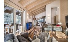 Aspen Lodge B31 - Book this luxury Chalet in Courchevel Moriond, France through Ski In Luxury. Features fireplace.