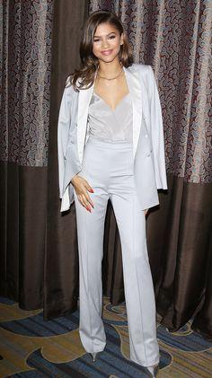 Zendaya wears a light gray tuxedo from Kayat, and pointy silver stilettos