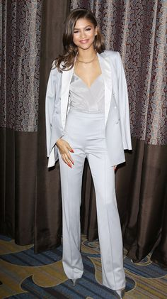 Zendaya wears a light gray tuxedo from Kayat, and pointy silver stilettos