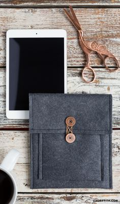 Make your own DIY felt iPad case and customize it with your favorite colors! The front pocket is stylish and functional, and you can add some cute buttons for a personal touch: https://liagriffith.com/felt-tablet-cover/