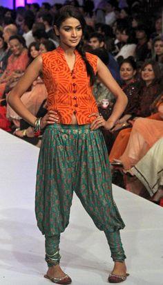 "KARACHI: Model walk down the ramp during ""Pakistan fashion Week 2012"" ."