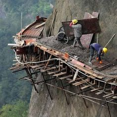 Chinese workers risk lives to build road on a cliff with no safety equipment The 21 builders are working in dangerous conditions to build China's longest sightseeing mountain road in Pingjiang county, Hunan Province Autocad, Dangerous Roads, Scary Places, Mission Impossible, Paint Colors For Living Room, Live Long, Interior Design Living Room, Concrete, Nature Photography