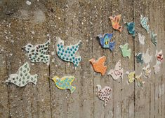 a flock of ceramic birds, bringing a little cheer to this dreery wall.