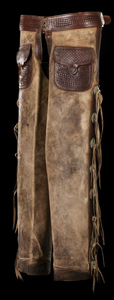 J. A. Donnel Shotgun Chaps. Well-marked J. A. Donnel, Rawlins, Wyo. step-in chaps with basketweave overlaid leather.