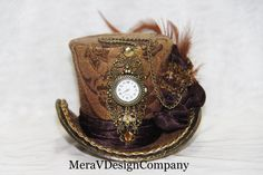 Brown Gold Mini Top Hat, Steampunk, Women Headpiece, Bridal Hat, Party Hat, Mad Hatter Hat, Working Clock, Victorian  READY TO SHIP. $45.00, via Etsy.