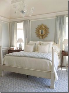 My current inspiration for my current bedroom. Love blue walls (BM glass slipper), the sunburst mirror, white, neutral linens. Jim Howard via www.thingsthatinspire.net