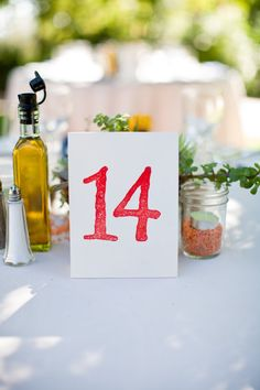 like use of mason jars, olive oil on table and table number card is simple and nice