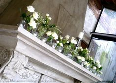 How Beautiful are these wedding-mantel-flowers Please Repin Click Here to see more wedding flowers http://www.fiftyflowers.com/?a_aid=FFlowers