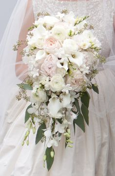 Many bride-to-bes might know the wedding flower they want in their own bouquet, however are a little mystified about the rest of the wedding flowers required to complete the ceremony and reception. Cascading Wedding Bouquets, Cascade Bouquet, Bride Bouquets, Bridal Flowers, Flower Bouquet Wedding, Floral Wedding, Purple Bouquets, Bridal Bouquet White, June Wedding Flowers