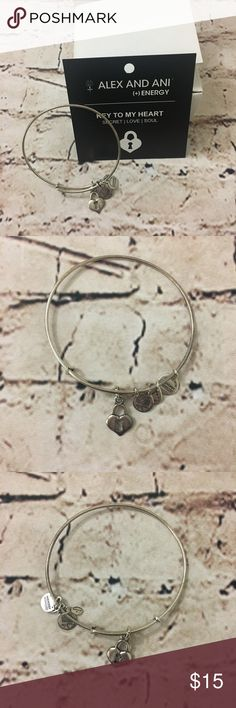 Alex and Ani | Key to my Heart bangle bracelet Secret. Love. Soul. Alex & Ani Key to my Heart silver charm bangle. Comes with card and box.   THERE IS TARNISHING. On the bangle mostly but possibly some on the charm itself. Still in excellent condition. Alex and Ani Jewelry Bracelets