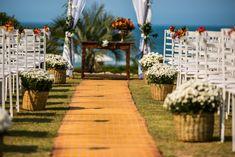 Casamento na praia com paleta vermelho e laranja