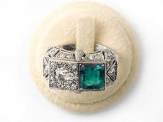 Art Deco platinum emerald and diamond contrarié ring.  1925. Pennisi, Milano