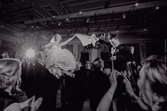 Chair lifting excitement during the hora / Wedding of Morgan Pressel and Andrew at The Breakers in Palm Beach, FL / Photo by Maloman Studios