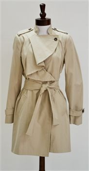 Diane Von Furstenberg  Spy Ruffle Trench Coat ,comes with a unique neck cut,that defiantly makes this one outfit stand out.