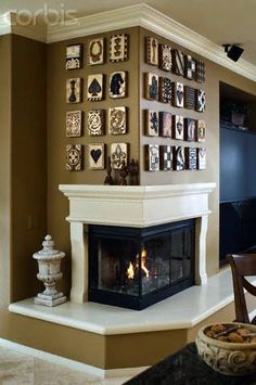 I'm loving this corner fireplace/hearth. Not so sure about the art above. But the fireplace is a must have in my Dream Home! Home Interior, Interior And Exterior, Interior Design, Modern Interior, Style At Home, Fireplace Mantels, Corner Fireplaces, Mantles, Fireplace Design