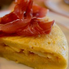 My favorite egg & potato dish. Patata Tortilla topped with Jamon Iberico from Tapisco in Lisbon by Chef Henrique Pessoa.    #travelswithtesa #boutiquetravelcompany #solopreneur #curatedexperiences #independenttravel #independenttraveler #virtuosoadvisor #affordableluxury #travelplanner #traveladvisor  #eatwithtesa #foodie #foodmatters #michelin