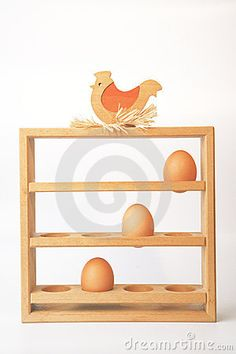 Wooden rooster egg holder with three eggs