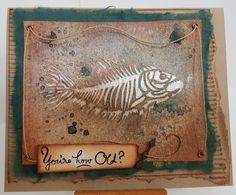 Mini Fish Fossils stencil 497s by The Crafters Workshop; Snow White Colour Blast Paste; Tawny Turquoise Moon Shadow Mist; How Old? by Stamp-it. Card by Susan of Art Attic Studio