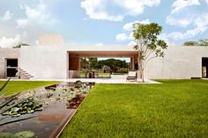 Located in Acanceh – home to an ancient Mayan archaeological site – in Yucatan, Mexico, Hacienda Sac Chich was constructed by Reyes Ríos + Larraín Arquitectos in 2010.    The home blurs the boundaries between 'indoors' and 'outdoors' by the use of openings which lead straight outside from bedrooms and living rooms; added to this earthy effect is the fact that much of the furniture is sculpted straight from the stone that makes up the house.