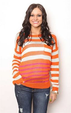 The Orange Slice Stripe Sweater at Dress and Dwell - Good things for you and your home. Price: $32. This knit striped sweater will add a dash of color to your spring style statements, just like Jessica Alba pair this sweater with your Level 99 Boyfriend Jeans for an effortless look on the go!