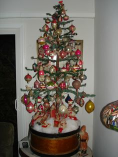 Larry Fraga's Antique Christmas Ornaments on a 4' feather tree!