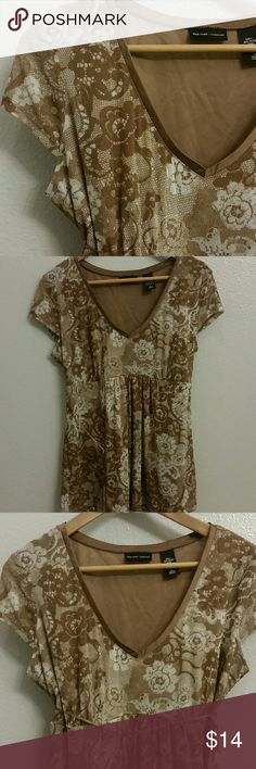 NYC Company Floral Top Beautiful, neutral, v-neck top featuring beige, white, tan and brown flowers; Optional Ribbon can be tied around front of waist or in back; Shell is 100% Nylon; built in 100% Polyester lining; New w/o tags, never worn New York & Company Tops