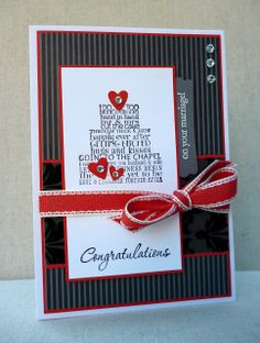 "Help the couple say ""I do"" with this handmade wedding card. Look how many delicious layers are on the top level! The cake is made of wedding-themed words and is topped off with red heart and rhinestone frosting. Luscious black papers with red accents and a red bow will make this card hard to forget."