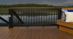 Earthwood Revolutions Tropical Decking in Walnut & Brownstone with Evolutions Railbuilder in Black. Timbertech.com