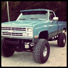 nice work on a vintage Chevy truck - lifted - painted an interesting color