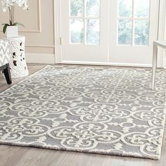 Alexis Rug: Anchor your living room seating group or define space in the den with this artfully hand-tufted wool rug, featuring an exotic tile motif for eye-catching appeal.