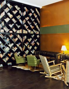 enochliew:  Brown TLV Hotel by Ruby Israeli The interior designer collaborated with architect Dario Grunzweig.  Those bookshelves!