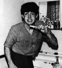 Young Paul McCartney brushing his teeth, and being cute.