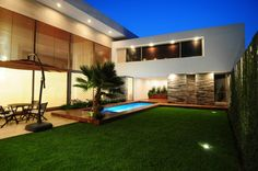 Architecture Home Design Exterior. Inspiring Modern Style Home Designs. Modern Home Backyard Design Ideas Come With Rectangle Outdoor Pool And Wooden Pool Floor Deck Plus Open Space Outdoor Living Space Together With Comfy Wooden Outdoor Furniture As Well As Huge Wide Exterior Sun Blinds Plus Fresh Green Lawn Backyard And Also Modern Built In Up Lights As Well As Stacked Stone Wall. Modern Home Designs. Inspiring Modern Home Designs. Modern Home Backyard Designs. Fresh Natural Home Backyard…