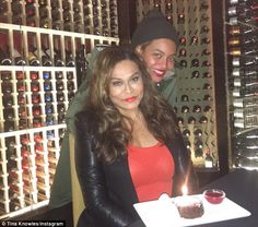 Surprise! Beyonce, wearing a beanie and a raincoat, showed up to celebrate her mom Tina Knowles' 62nd birthday at a Southern California restaurant on Tuesday night