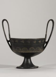 A LARGEETRUSCAN BUCCHERO KANTHAROS, LATE 7TH/EARLY 6TH CENTURY B.C.