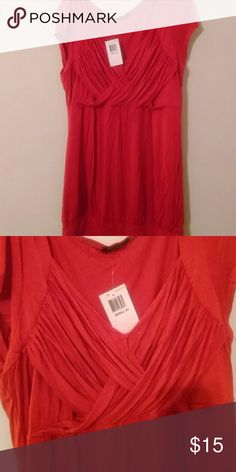 Red Shirt Red shirt with criss cross bunching at the top front of the shirt. With tags. Soprano Tops Blouses