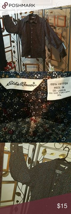 Eddie Bauer button down shirt size XL Flowery, button down Eddie Bauer shirt size XL.  Long sleeves with button cuffs. Print is blue with multicolored flowered pattern.  Very well made with minimal if any wear.  In great condition. 100% cotton. Eddie Bauer Tops Button Down Shirts