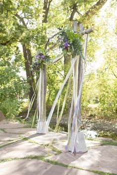 Aspen arbor with gorgeous decor and floating ribbons. Photo by Cary Jobe.