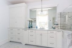 White Master Bathroom with sliding mirrors - Lewis and Weldon Custom Kitchens. White Master Bathroom, Custom Kitchens, Custom Cabinetry, Bath Design, Beautiful Bathrooms, Kitchen And Bath, Kitchen Design, Vanity, House Design