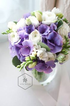 Dreamy!   made this pretty purple and white bouquet for a wedding today! with purple hydrangea, white ranunculus, freesia and eustoma :)