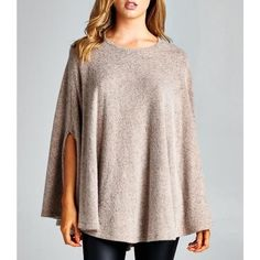 """Beyond the Stars"" Loose Cape Poncho Top Loose fit, round neck poncho cape top. Side slits for arm opening. Made with heavy weight, brushed French terry fabric that has a soft fuzzy texture. Drapes well and is warm. Fabric has good stretch. Available in heather grey, taupe and red. This listing is for the TAUPE. Brand new with tags. Runs large and fits up to a size M Bare Anthology Tops"