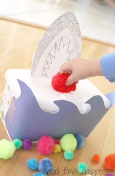 Talk about colors, practice counting, and strengthen those fine motor skills in our DIY Feed the Shark Game.