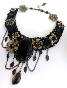 Nice design here. Creative use of the chains and brass flowers and leaves